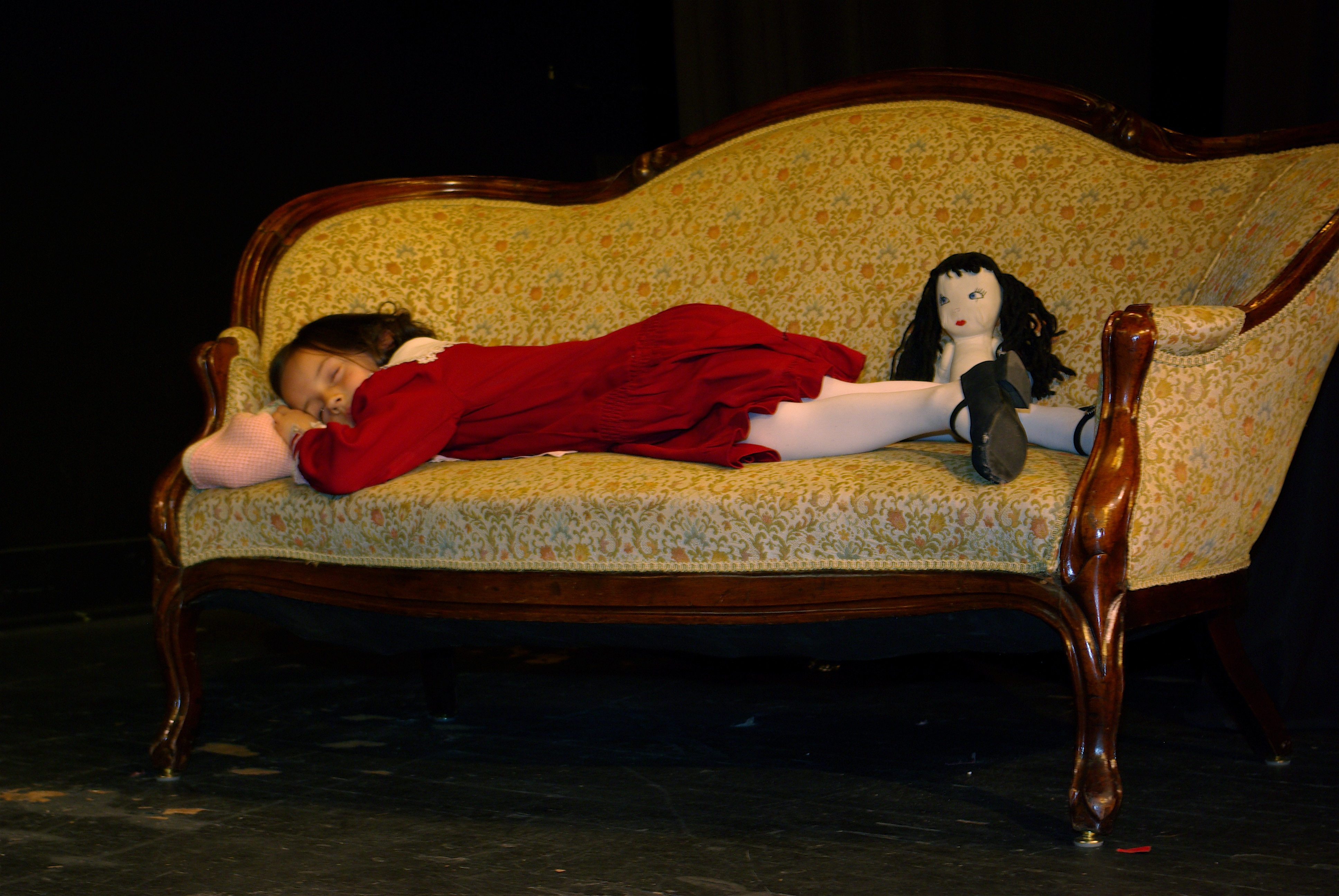 Jenny on couch with doll